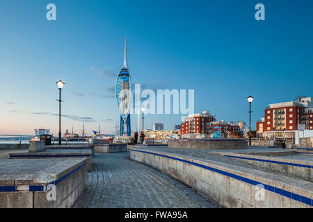 Night falls in Portsmouth, UK. Spinnaker tower in the distance. - Stock Photo