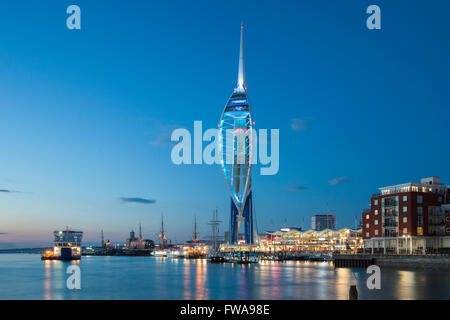 Night falls at Spinnaker Tower in Portsmouth Harbour, Hampshire, England. - Stock Photo