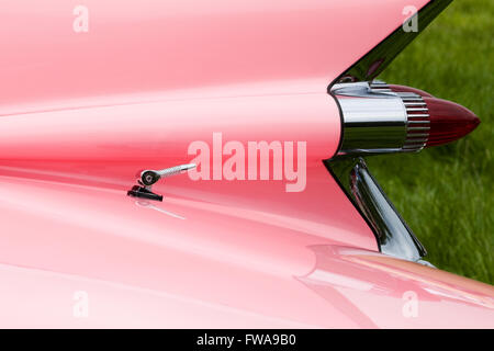 1959 Pink Cadillac. Sharp tail fin with dual bullet tail lights - Stock Photo