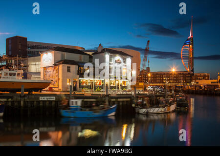 Night falls in Old Portsmouth, Hampshire, UK. Spinnaker Tower in the background. - Stock Photo