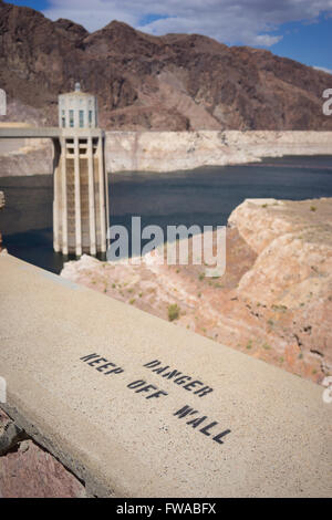 Warning of danger sign on the wall of the Hoover Dam near Las Vegas Nevada. - Stock Photo
