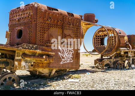 Rusty old steam train in the Uyuni desert, Bolivia - Stock Photo