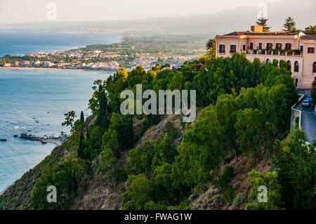 Sunset on the coast of Taormina, Messina, Sicily, Italy - Stock Photo
