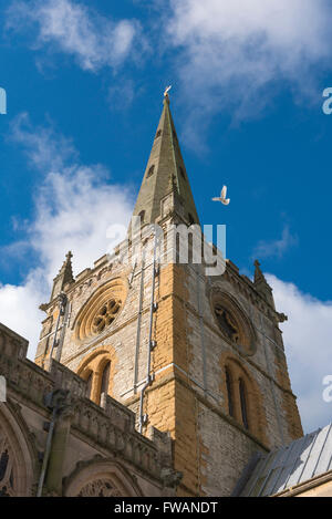 Tower and spire of Holy Trinity Church, site of Shakespeare's tomb, in Stratford Upon Avon, England. - Stock Photo