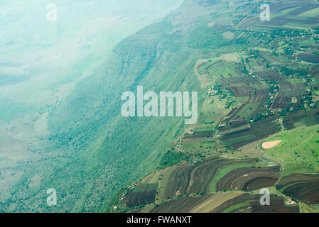 Aerial view of the eastern wall of the Great Rift Valley in Tanzania, photographed between Lake Manyara and Karatu. - Stock Photo
