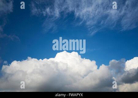 Cumulonimbus and Cirrus cloud formations against a bright blue sky. UK. - Stock Photo