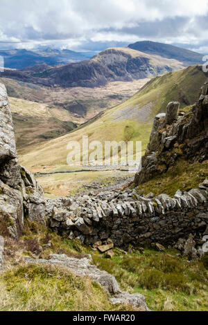 View SE to distant Moel Hebog across Cwm Pennant from Craig Cwm Silyn on Nantlle Ridge in Snowdonia National Park. - Stock Photo