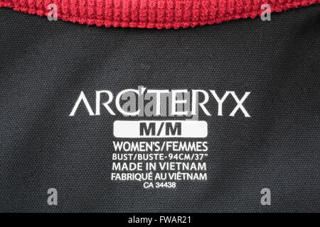 Arc'teryx clothing label on a women's outdoor garment made in Vietnam. England, UK, Britain - Stock Photo