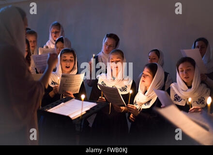 A Russian Orthodox women sing hymns during Veneration of the Cross Great Vespers service at the Theological Academy - Stock Photo