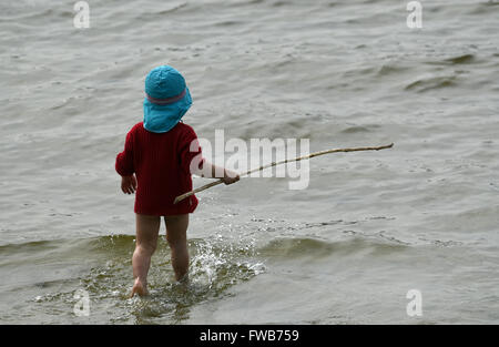 Berlin, Germany. 3rd Apr, 2016. A child in the water at Wannsee lake in Berlin, Germany, 3 April 2016. Photo: Ralf - Stock Photo