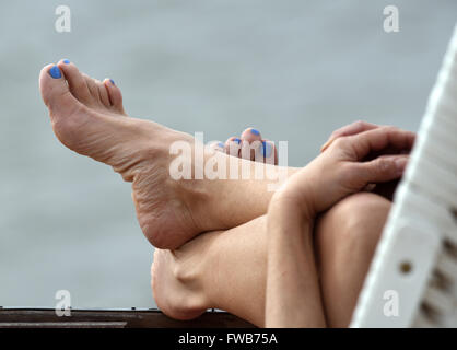 Berlin, Germany. 3rd Apr, 2016. A woman enjoying the sun in a beach chair at Wannsee lake in Berlin, Germany, 3 - Stock Photo