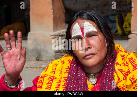 Nepal, Pashupatinath.  Female Hindu Sadhu (Ascetic).  She wears a nose pin in her nostril. - Stock Photo