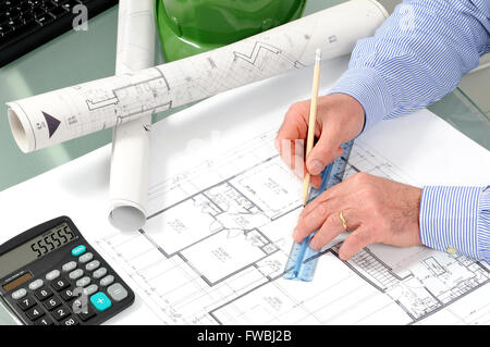 Engineer at work in the office on a residential construction project. - Stock Photo