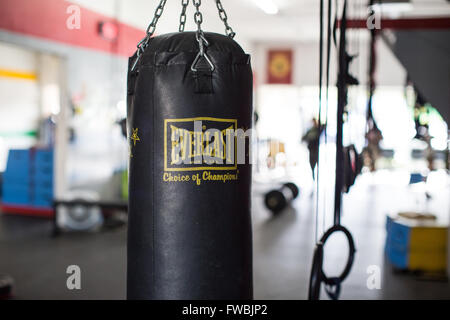 An Everlast boxing bag hanging inside a CrossFit box in California. - Stock Photo