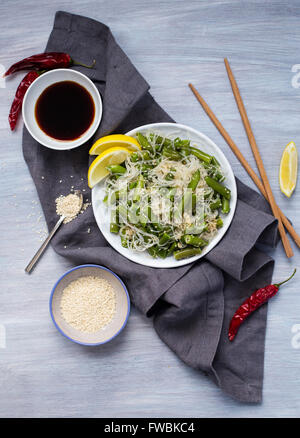 Cooked funchoza with green beans and toasted sesame seeds - Stock Photo