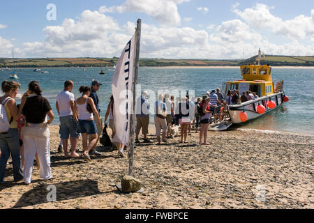 Passengers waiting for the ferry that will take them back to the cornish village of Padstow after spending the day - Stock Photo