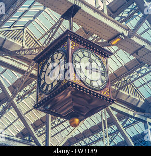 Retro Image Of The Vintage Clock And Meeting Point Under The Glass Roof Of Glasgow Central Station - Stock Photo