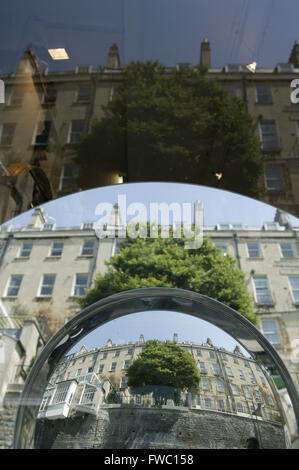 Bath Uk with shop front adn mirrors refelcting the city buildings. - Stock Photo