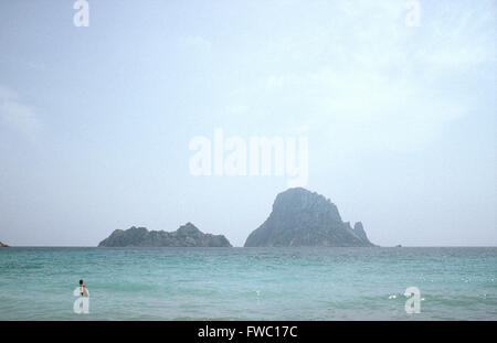 Lone swimmer in the sea on the island of Ibiza,Balearics,Spain. - Stock Photo