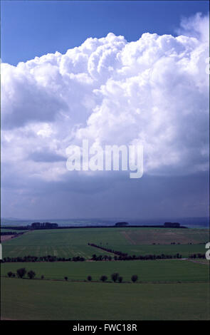 Huge clouds seen from White Horse hill across the country towards Swindon. - Stock Photo