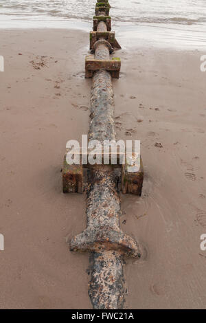 Sewage or waste water discharge pipe on Harlech beach in North Wales - Stock Photo