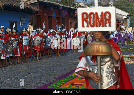 Men dressed as Roman legionaries lead the Jesus Nazareno del Milagro procession during Easter Holy Week in Antigua - Stock Photo