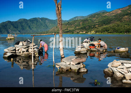 Woman wash clothing in Largo Atitlan, Santiago de Atitlan Guatemala - Stock Photo