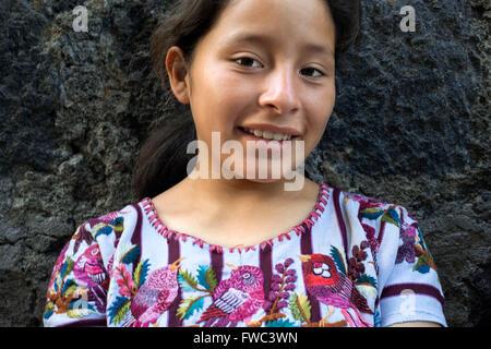 A gir Tzutujil dressed in traditional costume, San Juan de la Laguna, Sololá, Guatemala. - Stock Photo