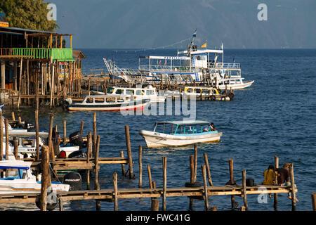 Boats in the pier of San Marcos La Laguna, Sololá, Guatemala. Santiago Atitlan, lake Atitlan, Guatemala. - Stock Photo