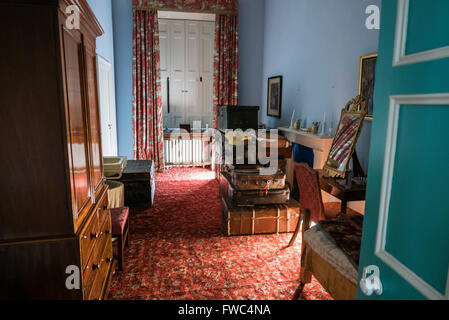 Luggage stored in a large closet room in an old fashioned stately home - Stock Photo