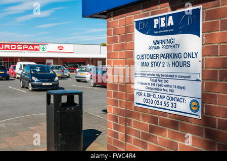 Parking Enforcement sign at a private carpark at a local shopping precinct. - Stock Photo