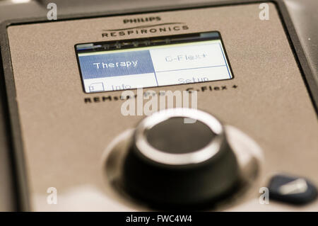 Philips Respironics System One CPAP machine showing the menu system with 'Therapy' selected. - Stock Photo