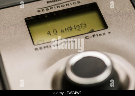 Philips Respironics System One CPAP machine set to a low air pressure of 4.0 cm H2O (LED backlight not illuminted) - Stock Photo