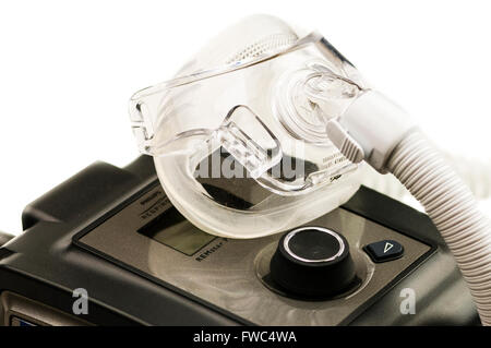 Philips Respironics System One CPAP machine with a Amara View mask - Stock Photo