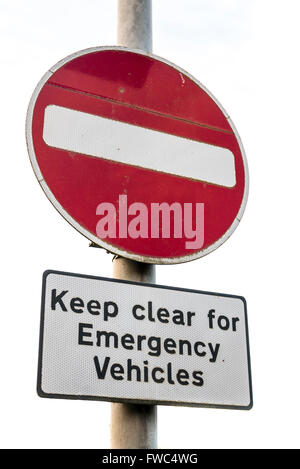 No entry road sign warning motorists to keep clear for emergency vehicles - Stock Photo