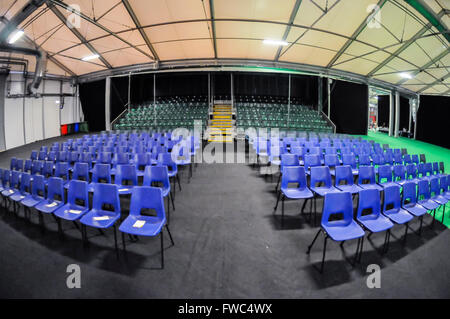 Empty chairs set out for a seminar in a conference centre, ready for the audience to arrive. - Stock Photo