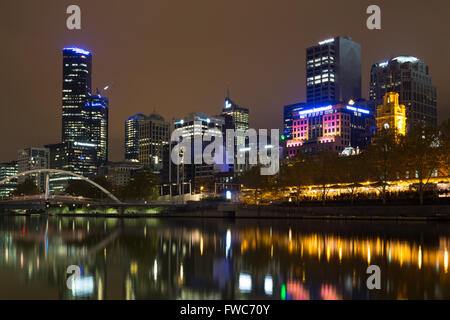 Melbourne, Australia - April 24, 2015: Skyline view over the Yarra River with reflections in the water. - Stock Photo
