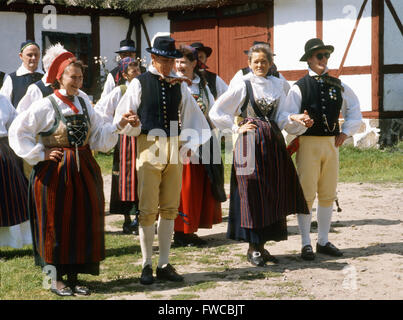 Folk dancers in traditional costumes - Stock Photo