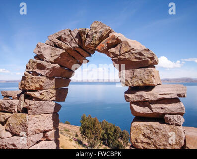 andes scenery with arch made of stone at Lake Titicaca in Peru (South America) - Stock Photo