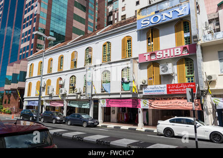 Row of building in downtown Bandar Seri Begawan, the capital of the sultanate of Brunei Darussalam. - Stock Photo
