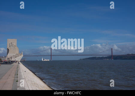 Discoveries monument with the 25th of April bridge behind, Lisbon, Portugal. - Stock Photo