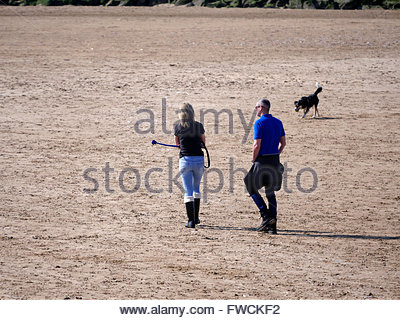New Brighton, UK. 3rd  April, 2016. UK Weather: Bright sunny day. People enjoy a walk on the beach Credit:  Alan - Stock Photo