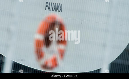 Hamburg, Germany. 04th Apr, 2016. The word Panama is seen on a container ship behind a life belt at the harbour - Stock Photo