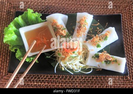 Upscale spring rolls dish at Mango Bay Resort, Pho Quoc island, Vietnam, Asia - Stock Photo