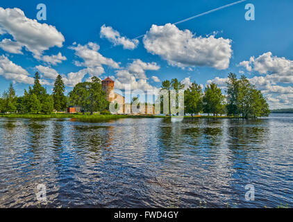 Lake view with reflections of Olavinlinna Olofsborg, the 15th-century medieval three-tower castle located in Savonlinna, - Stock Photo