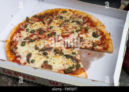 hot original italian pizza in cardboard box, Italy - Stock Photo