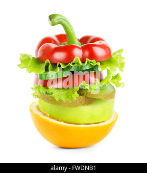 Stack of mixed fruit and vegetable slices on white background. Food concept. Fresh food - Stock Photo