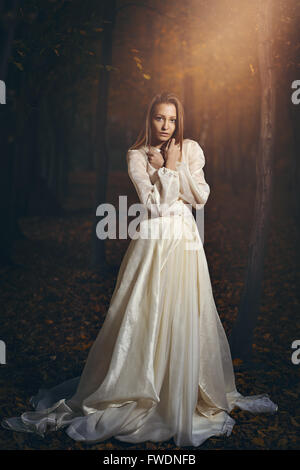 Victorian dressed woman in magical forest. Romantic and fantasy