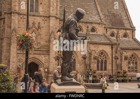 Memorial statue to the Durham Light Infantry in Market Square,Durham City,England,UK by Alan Beattie with church - Stock Photo