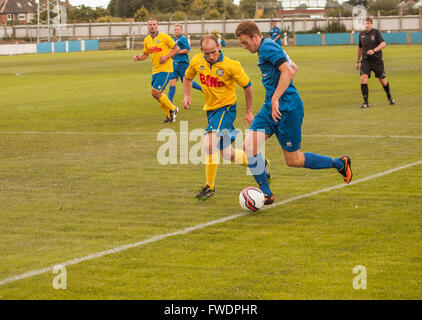 A close up of amateur footballers playing in the Northern Leagues in north east England,UK - Stock Photo